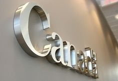 Brushed stainless steel metal office lobby signage - signs for corporate office made of raised stainless steel metal letters in reception area by ArtSigns Logo Design Love, Signage Design, Banner Design, Design Design, Graphic Design, Office Signage, Wayfinding Signage, Directional Signage, Metal Letters