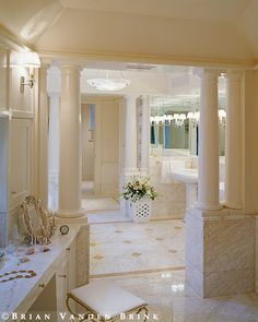 Catalano Architects. Luxury marble bath.  Creamy whites, with gold always fresh. Great layout idea with vanity and half walls using pillars Mirrored walls and marble floor design with professional lighting for flawless bathroom ideas