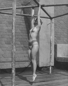 Suspended nude men