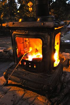 salvaged woodstove for firepit; brilliant. The fire heats the iron too for lasting warmth.