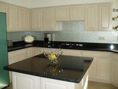 Black granite white cabinets