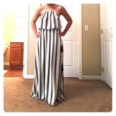 Maxi dress from the Loft! Pretty black and white maxi dress with cute tassel detail! Never worn, no signs of wear. Size XS LOFT Dresses Maxi
