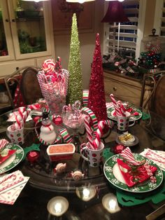 Christmas table setting  Love the candy cane in the cups and for decorations. B