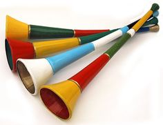 """Vuvuzela (or Lepatata): A stadium horn commonly blown at South African Football Matches. Often made of plastic and approximately 1m long it  emits a loud monotone B flat. ( A less disharmonious sound can be produced by blowing it like a trombone, dropping the corners of the mouth as in the letter """"m"""" and blowing through the lips to make them vibrate.)"""