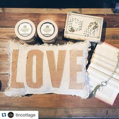 @tincottage  A few of our favorite LOVEly things. Pearls pillows and poured candles. #valentinesday #valentine #tincottage #southernfireflycandles #downtownfranklin #2ndSouthDistrict
