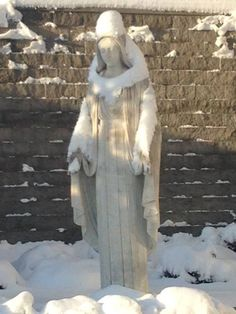 The way the snow fell it looks like Mary is carrying a person. What makes the image even more meaningful is that this statue is outside of a cancer hospital--Mercy Hospital, Council Bluffs.