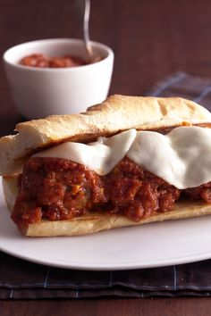 Add the finished product of our favorite meatball recipe to a hoagie bun for a delicious family dinner.