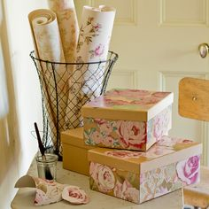 Great idea for using left over wallpaper and the accessories will match the scheme too!