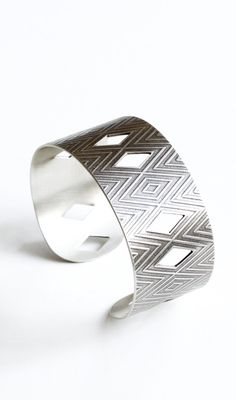 """Wide silver cuff with a geometric pattern and handsawn cut-outs, light patina adds to the modern feel of this striking design - """"Arona Cuff"""""""