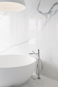 A contemporary bathroom look, complete with Fantini Milano bathtub fixtures. Flagship Penthouse, designed by Adam Becker Design, 2017 Fantini Design Awards winner.