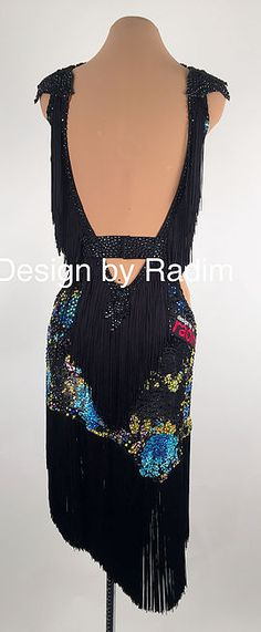 A collection of Latin Ballroom Dresses and Rhythm Dresses available for purchase.