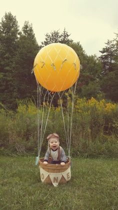 Love this :). Hot air balloon photo prop. One year photos.