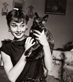 Audrey and her tortie. Ok so it's not a black cat but still a stunning black and white photo.