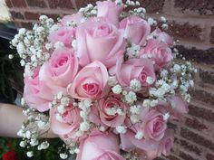bridal bouquet with pink roses with baby's breath