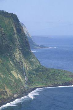 Waterfall and Sea Cliffs at Waipio Valley, The Big Island, Hawaii.