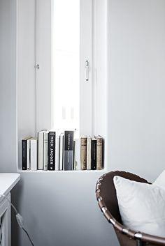 Grey home with a black kitchen - via Coco Lapine Design