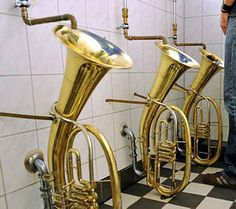 odd , curiosity tuba toilets , oompah band deaths must be big here if there are so many instruments left around to use in such a freaky way These unusual urinals at a pub in Freiburg, South Germany, were put in by landlord Martin Hartmann