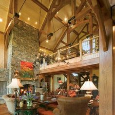 Gorgeous #GreatRoom! #TimberFrameTuesday #timberframe #NaturalElementHomes #lighting