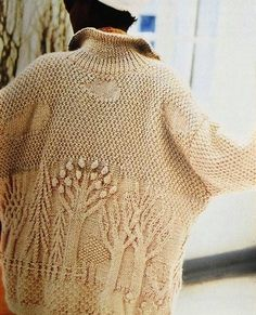 Wow.  This blog entry is Russian, but the pattern jpegs are in English.  If you'd rather have a pdf download, the original is on the Vogue Knitting website and costs $6: http://store.vogueknitting.com/p-232-enchanted-forest-cardigan.aspx