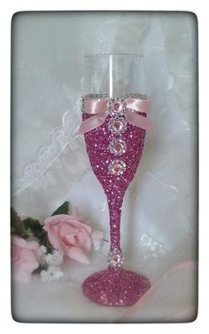 Toasting flute with bling and ribbon for by JuicyBalloons on Etsy Glitter Wine Glasses, Diy Wine Glasses, Decorated Wine Glasses, Painted Wine Glasses, Champagne Glasses, Wine Glass Crafts, Wine Bottle Crafts, Bottle Art, Wedding Glasses