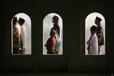Eid in Indonesia - Indonesian Muslims perform Eid al-Fitr prayers that mark the end of the holy fasting month of Ramadan at a mosque in Porong, East Java, Indonesia, Sunday, Aug. 19, 2012. (AP Photo/Trisnadi)