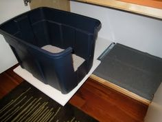 This time they tricked out the bottom to roll out so you can access the litter box easier.  They also added a nice kitty litter mat, thus FORCING the cat to walk across it (i've seen many kitties HOP over mats that people leave out in exposed Boxes).