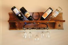 Wine Rack Holder with old rake to hold wine glasses.