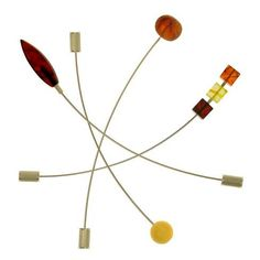 Maryla Dubiel brooches. Amber and sterling silver.