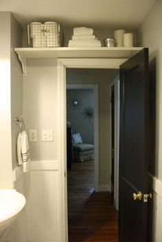 To maximize space in the bathroom add a shelf over the door to store extras like toilet paper and extra towels. http://hative.com/clever-bathroom-storage-ideas/