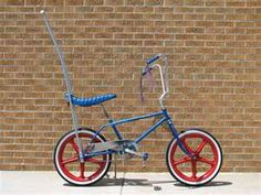 Bikes with banana seats and sissy bars.>>>Mine was blue with a bright sparkly orange banana seat with two yellow and blue stripes going down the middle and orange handle grips with tassles!