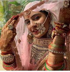 "Amongst all the jewellery that a bride wears on her ""D day"" the most captivating is the bridal nose ring. Selecting a nose ring is not an easy task, but we are Indian Bridal Outfits, Indian Wedding Jewelry, Indian Dresses, Indian Bridal Wear, Bridal Jewellery, Indian Wear, Rajasthani Bride, Rajasthani Dress, Nose Ring Designs"