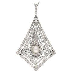 Art Deco natural pearl and diamond filigree pendant, French, circa 1920.