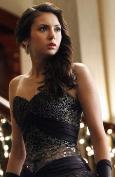 Vampire Diaries Elena Gilbert Mikaelson Ball Gown Replica - Strapless ball gown. Full skirt dress, chiffon over sequin skirt, lace appliqued bodice. Bodice is stiffened and underwired. Designer satin sash waist, satin lace-up back and bow.- £619 **£50 DEPOSIT THEN FROM ONLY £10.94 PER WEEK