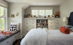 Bedroom builtins with half high windiw  Hills Beach cottage, Portland, Maine. Whitten Architects.