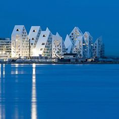 exterior—Denmark's new glacier-inspired waterfront development, Isbjerget, located in Aarhus and designed by CEBRA, JDS, SeARCH and Lois Paillard; Aarhus, Art Et Architecture, Amazing Architecture, Contemporary Architecture, Sustainable Architecture, Visit Denmark, Denmark Travel, Unique Buildings, Amazing Buildings