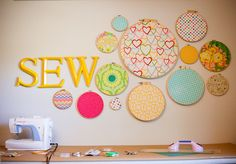 Love this...Emma's name on yellow and fabric embroidery hoops in turquoise, grey and tellow
