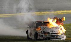 Kertus Davis climbs out of his car after it catches fire during the NASCAR Nationwide Series at Daytona International Speedway in Daytona Beach. Nascar Heat, Nascar Crash, Nascar Racing, Auto Racing, Daytona International Speedway, Daytona Beach, Race Day, Motocross, Dream Life