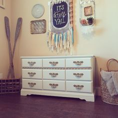 Shabby chic gallery wall and general finishes antique white. Love!
