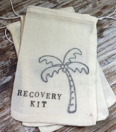 """These 4x6 inch (10x15 cm) bags are hand stamped with """"Recovery Kit"""" and a silver glitter palm tree. Perfect addition to your beach wedding! Hand them out as fav"""