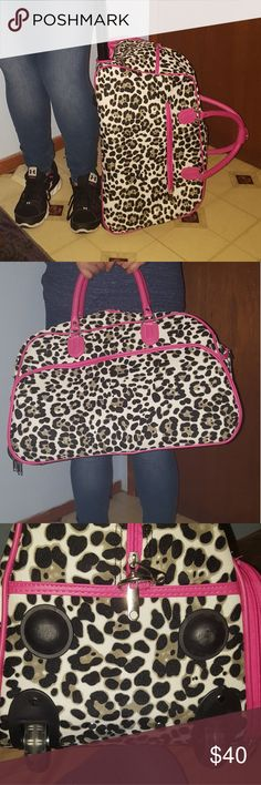 """🌸Rolly medium overnight bag🌸 Medium sized pink, gray, black and white chetta print Rollie carry on or overnight bag. Measurements aren't exact length is about 20"""" height is about 13"""" width is about 12"""", when the roller handle is up from floor to handle is about 40"""" . Interior has one zip pocket and 2 slip pockets and the out side has 1 large front zip pocket and 1 small back zip pocket. I did use this once so there is minor scuff marks on all six nobs and the wheels. Also comes with a…"""