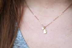 Tiny Gold Michigan Necklace by ShopOhSoAntsy on Etsy https://www.etsy.com/listing/188762371/tiny-gold-michigan-necklace