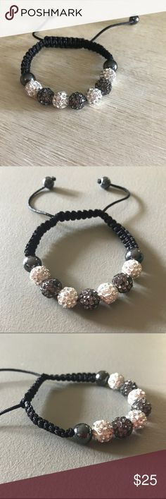Rhinestone adjustable bracelet Black and white rhinestone ball bracelet with braided design and adjustable wrist string. Cute and stylish. Someone bought it for me. Not much of a jewelry person so never wore it. No flaws. Like new. Jewelry Bracelets