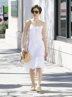 Modern princess: Lily Collins wears a snow white sundress to go shopping in Los Angeles...