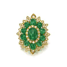 CABOCHON EMERALD AND DIAMOND BROOCH The domed oval floral motif set with 11 oval cabochon emeralds weighing approximately 30.75 carats, accented in the center and around the edges with round diamonds weighing approximately 3.40 carats, mounted in 18 karat gold.