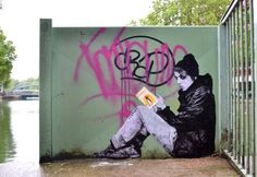 Books - street art by Levalet - French street artist Levalet creates amazing wall collages (using actual books) across France, in a large project called Jeu de dupes.