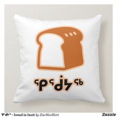 A brown bread with the Inuit word for bread(ᕿᖂᔭᖅ) under it in the color black. Brown Bread, White Elephant Gifts, Free Sewing, Custom Pillows, Your Design, Create Your Own, Art Pieces, Color Black, Throw Pillows