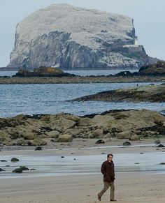 Colin Firth in North Berwick, East Lothian, with Bass Rock in the background, filming The Railway Man