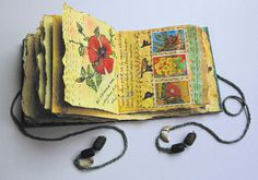 Handmade Book by Frances Pickering - An example of one of Frances's unique hand-made books, based on flowers from her garden and worked in drawings and stitch on recycled pages from gardening magazines.