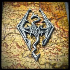 Custom made Skyrim fan's handmade leather bound journal for chronicles his adventures across the lands of Skyrim… Size of journal is 10.5 x 7.5 inches; thickness is 2 inches; have a hand carved logo; unique printed map and appropriate embossed gray leather… ______________ http://www.alexlibris-bookart.com/