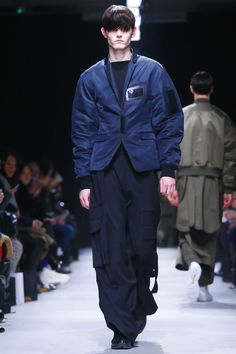 Volume play has been part and parcel of Korean designer Juun J's body of work since its inception.  As has the exploration of wardrobe that hinges on the notion of a uniform. In KAKH,...